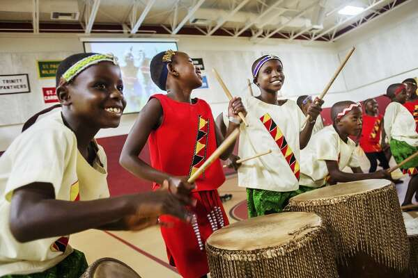 Members of the African Children's Choir perform for an audience of faculty and students at St. John's Lutheran School Friday, Oct. 18, 2019 in Midland. (Katy Kildee/kkildee@mdn.net)
