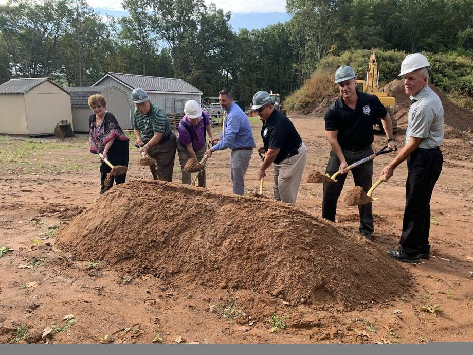 Town officials, led by Mayor Enzo Faienza, center in blue dress shirt, break ground for the new Public Works/WPCA facility. The officials include at left Alice Kelly, chairwoman of the WPCA, and Public Works Director Louis J. Spina and Town Engineer Jon Harriman in dark blue polo shirts to Faienza's immediate left. Photo: Mike Shewokis, Cromwell Engineering Technician.