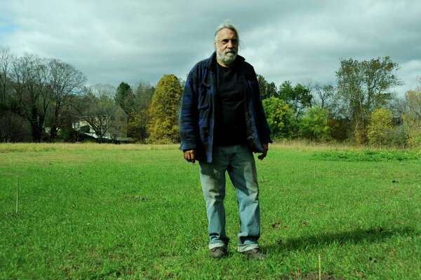 Curtis Ek, a farmer in New Milford, stands in the field where 85 percent of his hemp plants were stolen. Hemp farmers across the state are reporting thefts as the state pilots growing this profitable crop. Friday, Oct. 18, 2019.