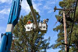 PG&E construction workers work on the power lines off Armstrong Woods Rd in Guerneville, Ca on Wednesday October 16, 2019.