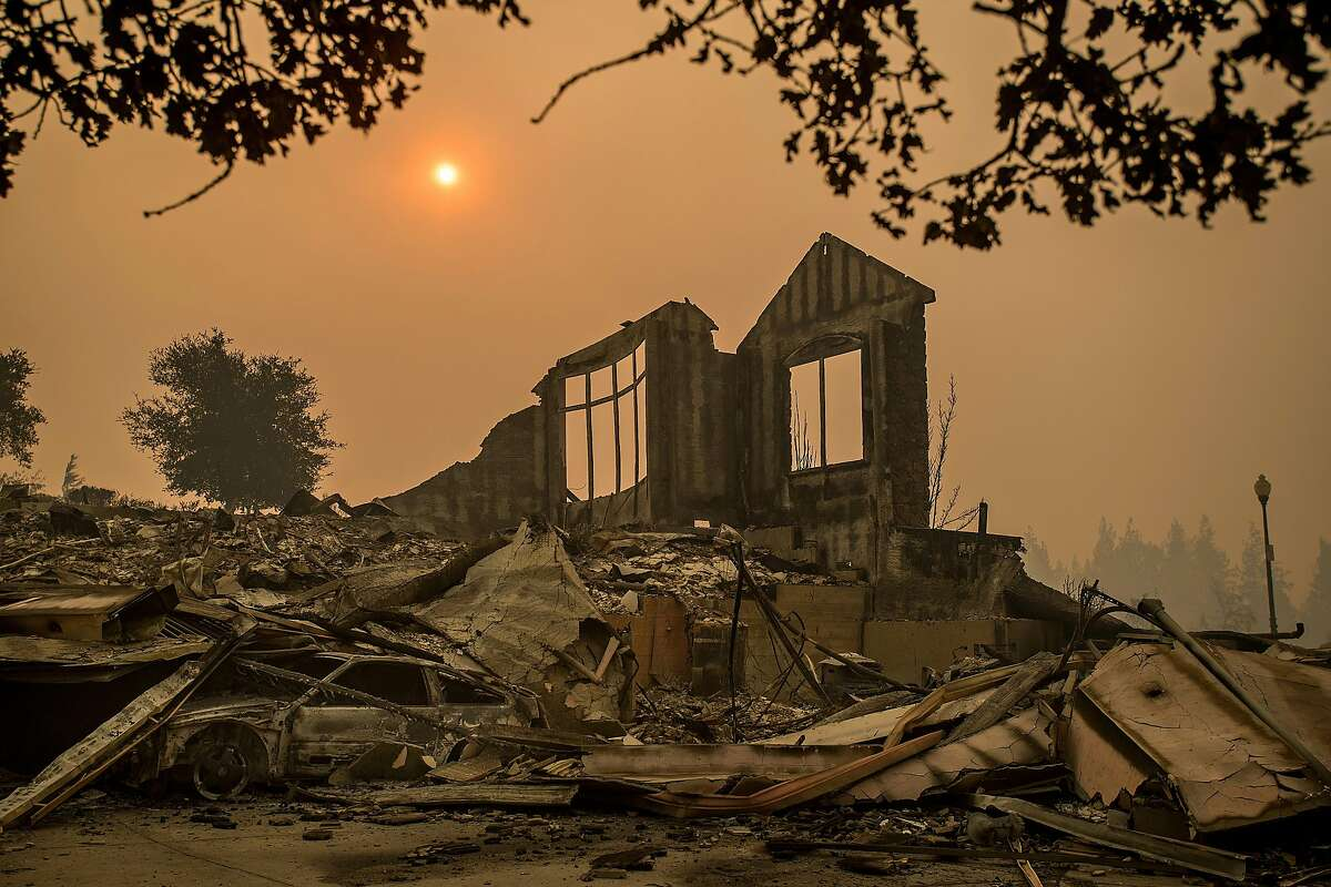 A wall stands at a Chanterelle Circle home destroyed by the Tubbs fire in the Fountaingrove area of Santa Rosa, Calif., on Tuesday, Oct. 10, 2017. Wildfires are expected to increase as climate change heats up, and a new analysis shows the economic costs of doing nothing about climate change will exceed the costs of tackling it.