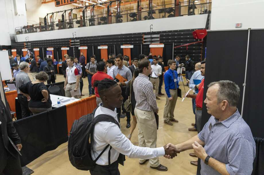 The University of Texas of the Permian Basin hosted a job fair Oct. 10, 2019 in the gym. More than 40 companies attended with openings for sales, engineers, teachers and managers. Photo: Jacy Lewis/Reporter-Telegram