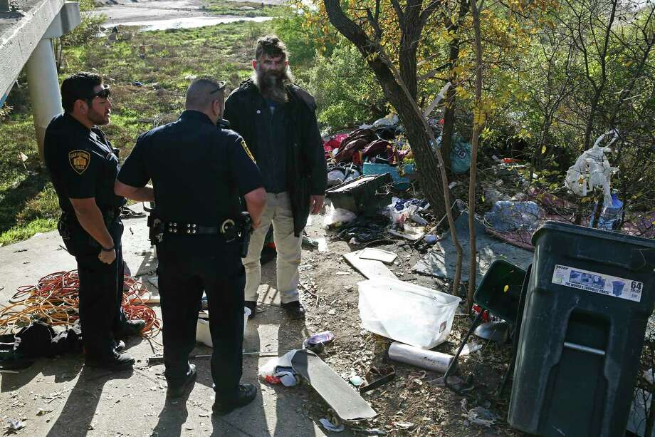Leland Ray Wood, 51, formerly of Lancaster, California, talks with San Antonio Fear Free Environment Officers Johnny Perez, left, and Elliott Valdez, at an encampment by a bridge on Culebra Road, Dec. 4, 2018. The city is receiving help from California to address homelessness. A reader finds it ironic. Photo: JERRY LARA /Staff Photographer / © 2018 San Antonio Express-News