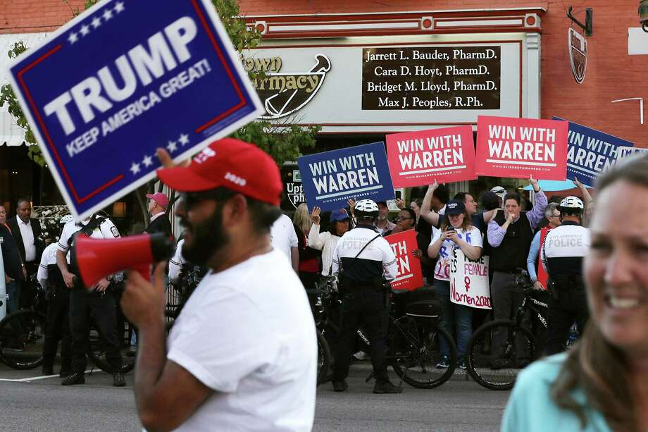 Supporters of President Donald Trump and Sen. Elizabeth Warren rally on opposite corners of an intersection outside the site of the most recent Democratic presidential debate. Just a hunch, but they probably did not have much of a political conversation. Photo: Chip Somodevilla /Getty Images / 2019 Getty Images