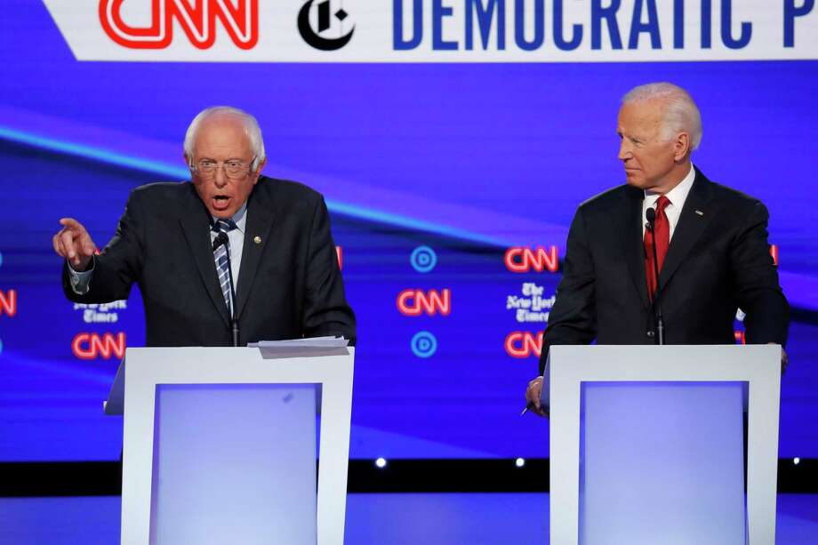 Presidential candidate Sen. Bernie Sanders, left, speaks of Medicare for All as former Vice President Joe Biden listens during a Democratic primary debate hosted at Otterbein University in Ohio on Tuesday. Photo: John Minchillo /Associated Press / Copyright 2019 The Associated Press. All rights reserved