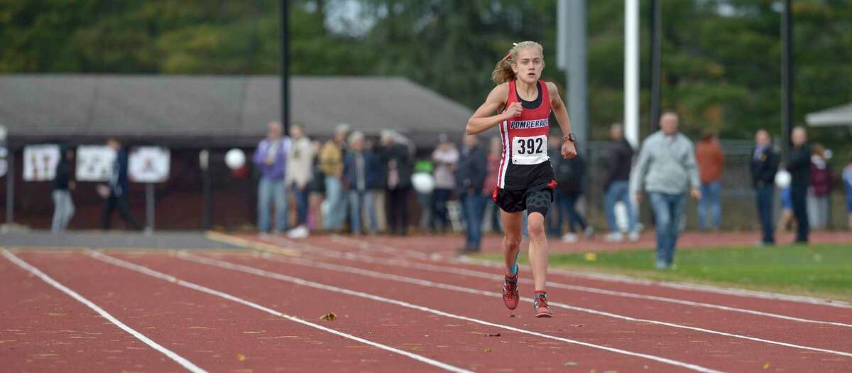 Pomperaug's Kate Wiser (392) finished first in the girls SWC cross country championship race with a time of 17:52.14, Friday afternoon, October 18, 2019, at Bethel High School, Bethel, Conn.