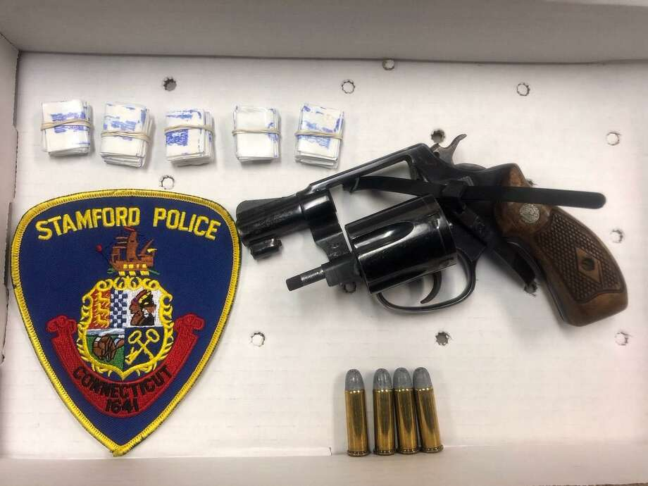 The gun and heroin seized from Dashawn Johnson during a drug bust in Stamford on Oct. 23, 2018. Photo: Stamford Police / Contributed