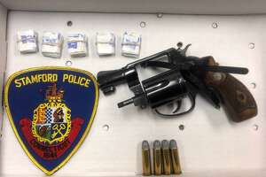The gun and heroin seized from Dashawn Johnson during a drug bust in Stamford on Oct. 23, 2018.