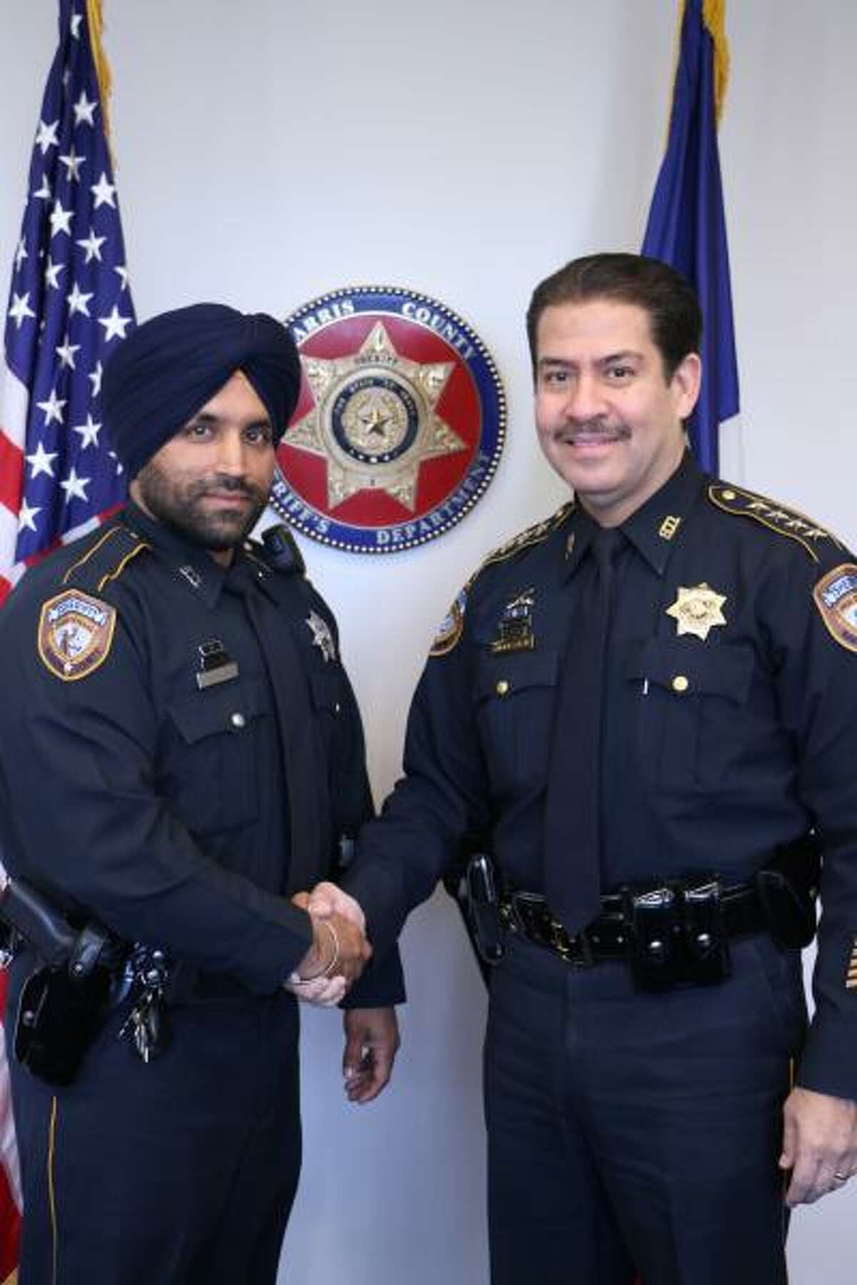 Harris County Sheriff's Deputy Sandeep Dhaliwal, left, and then-sheriff Adrian Garcia. Garcia, now the Harris County commissioner for Precinct 2, wants to name the Harris County Criminal Justice Center after Dhaliwal.