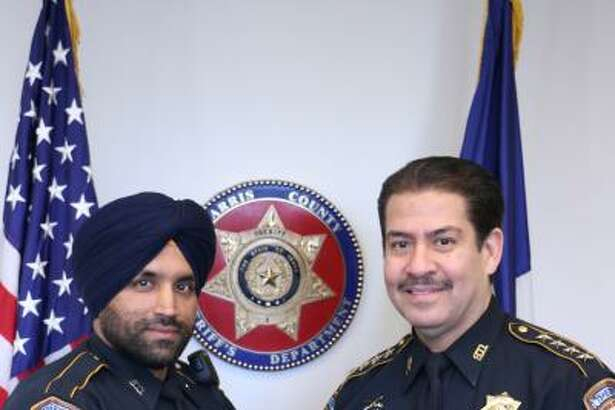 Harris County Sheriff's deputy Sandeep Dhaliwal, died after being shot during a traffic stop in late September. He joined the sheriff's office in 2011, and gained national prominence after fighting for religious accomodations to wear a beard, turban, and other articles of faith central to his identity as a practicing Sikh. He is shown here with Adrian Garcia, sheriff when he joined the department.