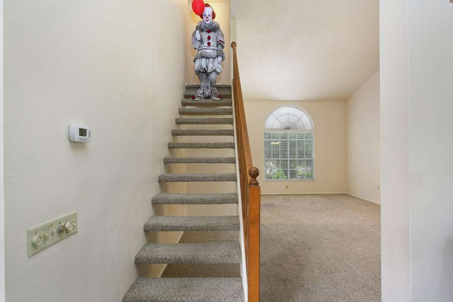 "Realtor Kristy Dakin told mySA.com she tapped into her spooky side to create the listing for the 9338 Chattanooga Drive home and dressed up as Pennywise from the horror movie ""It"" for the staging pictures. She said the four-bedroom, two-story home hit the market Thursday night with photos featuring her as the clown. Photo: Courtesy, Kristy Dakin"