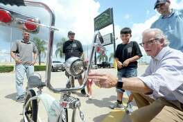 Vladimir Pitman talks with Gerald Condon about the details of his renovations as he and his father drop off his bicycle at Collision & Classics in Beaumont Monday, Aug. 5. Condon and his staff were so touched by Vladimir's stolen bicycle story that they reached out to the family to offer to do all the upgrades that Vladimir had planned after getting his stolen bike back for the second time. Photo taken Monday, August 5, 2019 Kim Brent/The Enterprise