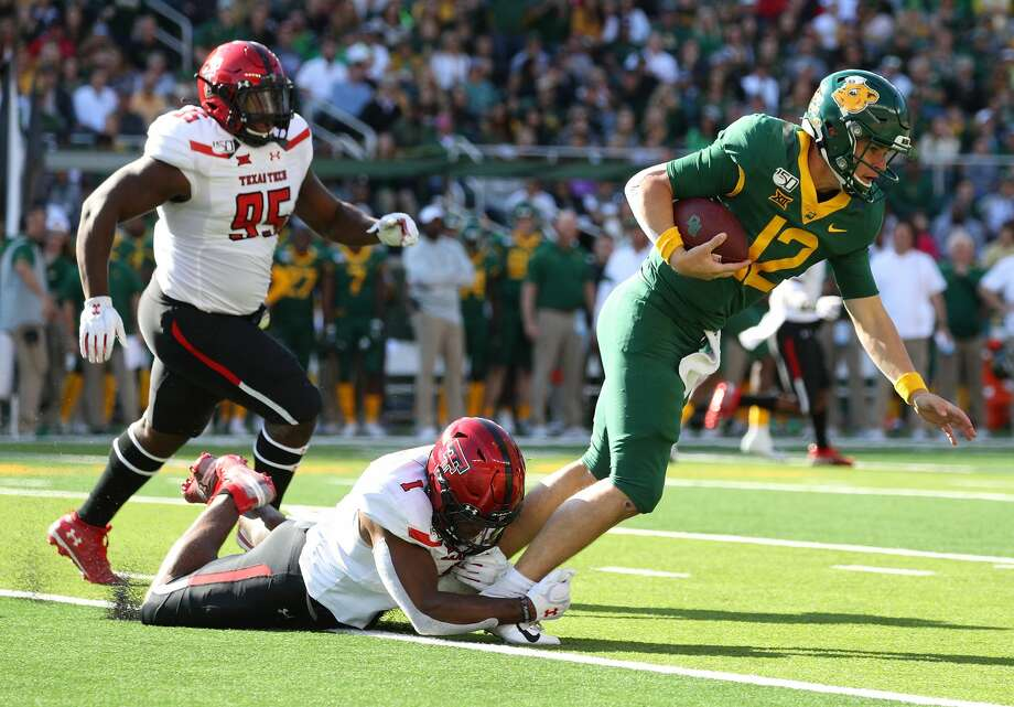 Jordyn Brooks #1 of the Texas Tech Red Raiders tackles Charlie Brewer #12 of the Baylor Bears in the first half on October 12, 2019 in Waco. (Photo by Richard Rodriguez/Getty Images) Photo: Richard Rodriguez/Getty Images