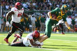 Jordyn Brooks #1 of the Texas Tech Red Raiders tackles Charlie Brewer #12 of the Baylor Bears in the first half on October 12, 2019 in Waco. (Photo by Richard Rodriguez/Getty Images)