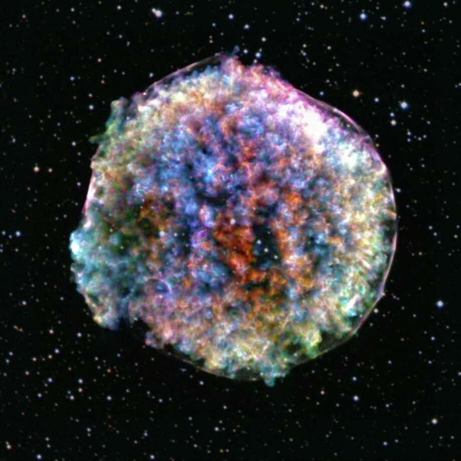 This composite image shows the Tycho supernova as seen by the Chandra X-ray Observatory. Photo: NASA/CXC/SAO.; Optical: DSS