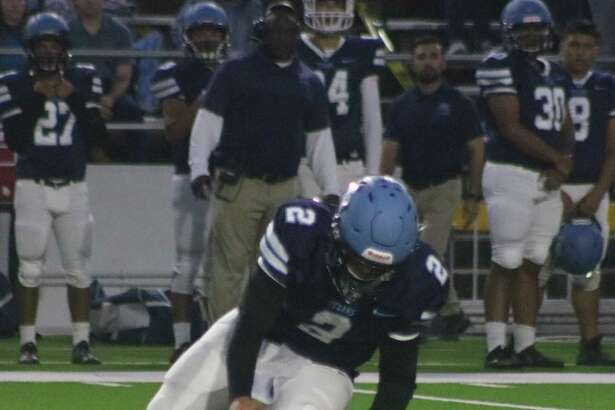 A high snap from center led to this Sam Rayburn fumble Thursday night as quarterback Brayan Aguirre bids to recover it.