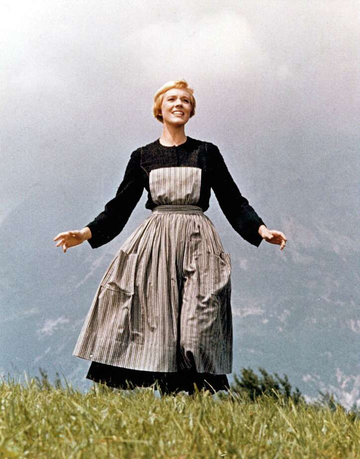 "Actress Julie Andrews performs musical number in the movie ""The Sound Of Music"" directed by Robert Wise in 1964. Though this is the opening scene of the film, it is the final sequence shot in Europe before the cast and crew returned to Los Angeles. Some 50 years later, a crew will be coming together on Saturday, Nov. 29, 2014, at the Westport Library in Westport, Conn., to singalong to this classic film. (Photo by Michael Ochs Archives/Getty Images) Photo: Michael Ochs Archives, Handout / Getty Images / Stamford Advocate"