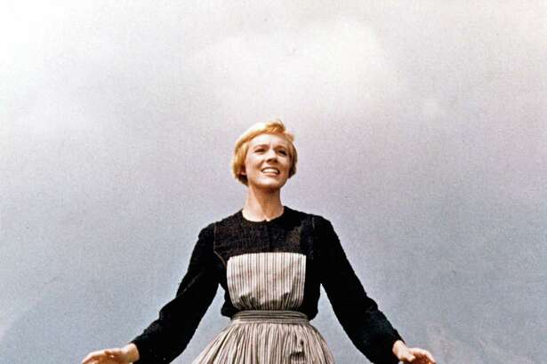 "Actress Julie Andrews performs musical number in the movie ""The Sound Of Music"" directed by Robert Wise in 1964. Though this is the opening scene of the film, it is the final sequence shot in Europe before the cast and crew returned to Los Angeles. Some 50 years later, a crew will be coming together on Saturday, Nov. 29, 2014, at the Westport Library in Westport, Conn., to singalong to this classic film. (Photo by Michael Ochs Archives/Getty Images)"