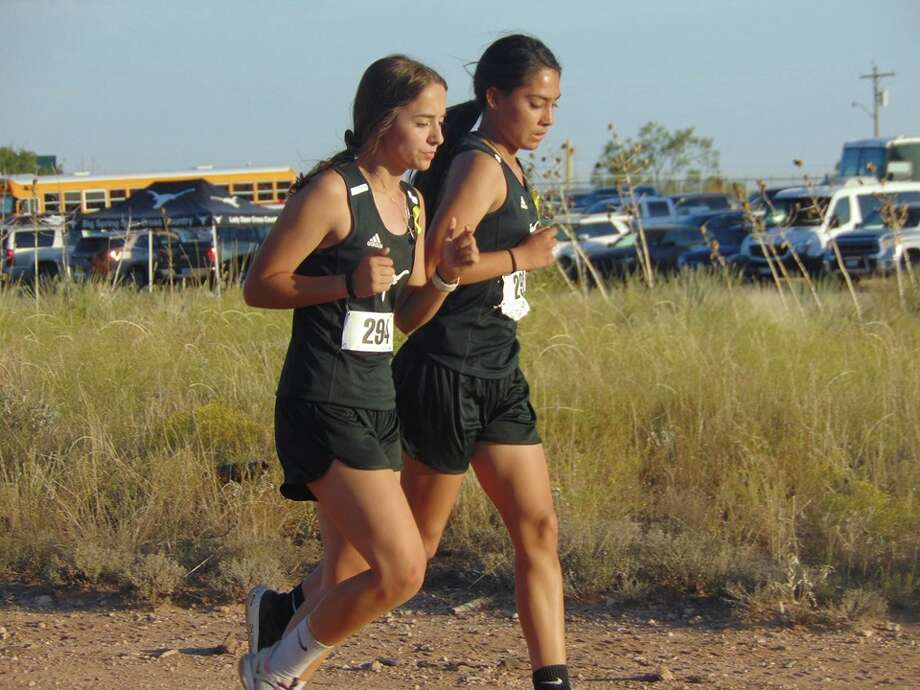A pair of Big Spring girls runners compete at the District 5-4A Cross-Country Meet, Oct. 16 in Snyder. The Big Spring girls placed third to qualify for the Region I-4A meet, Oct. 28 in Lubbock. Photo courtesy of Amanda Goode Photo: Amanda Goode