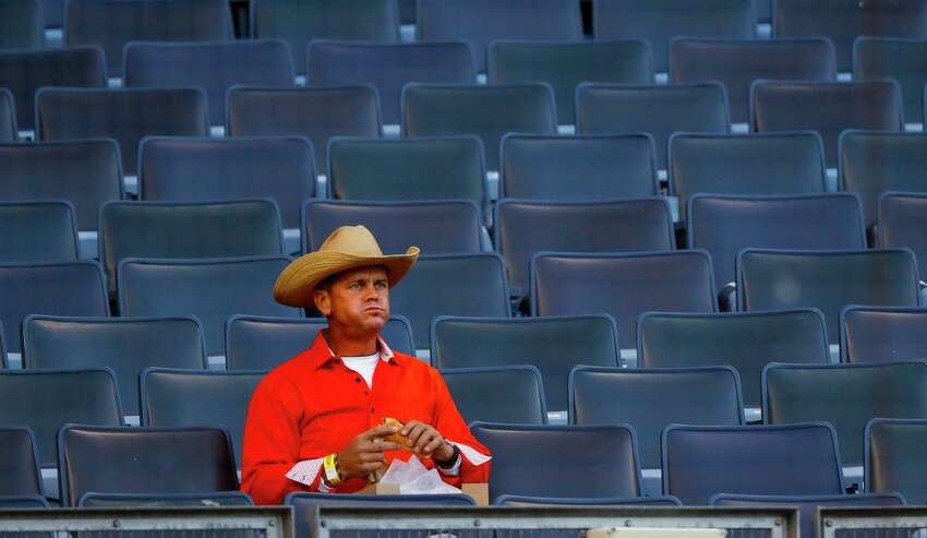 A fans eats a hot dog on the stands before Game 5 of the American League Championship Series at Yankee Stadium on Friday, Oct. 18, 2019, in New York.
