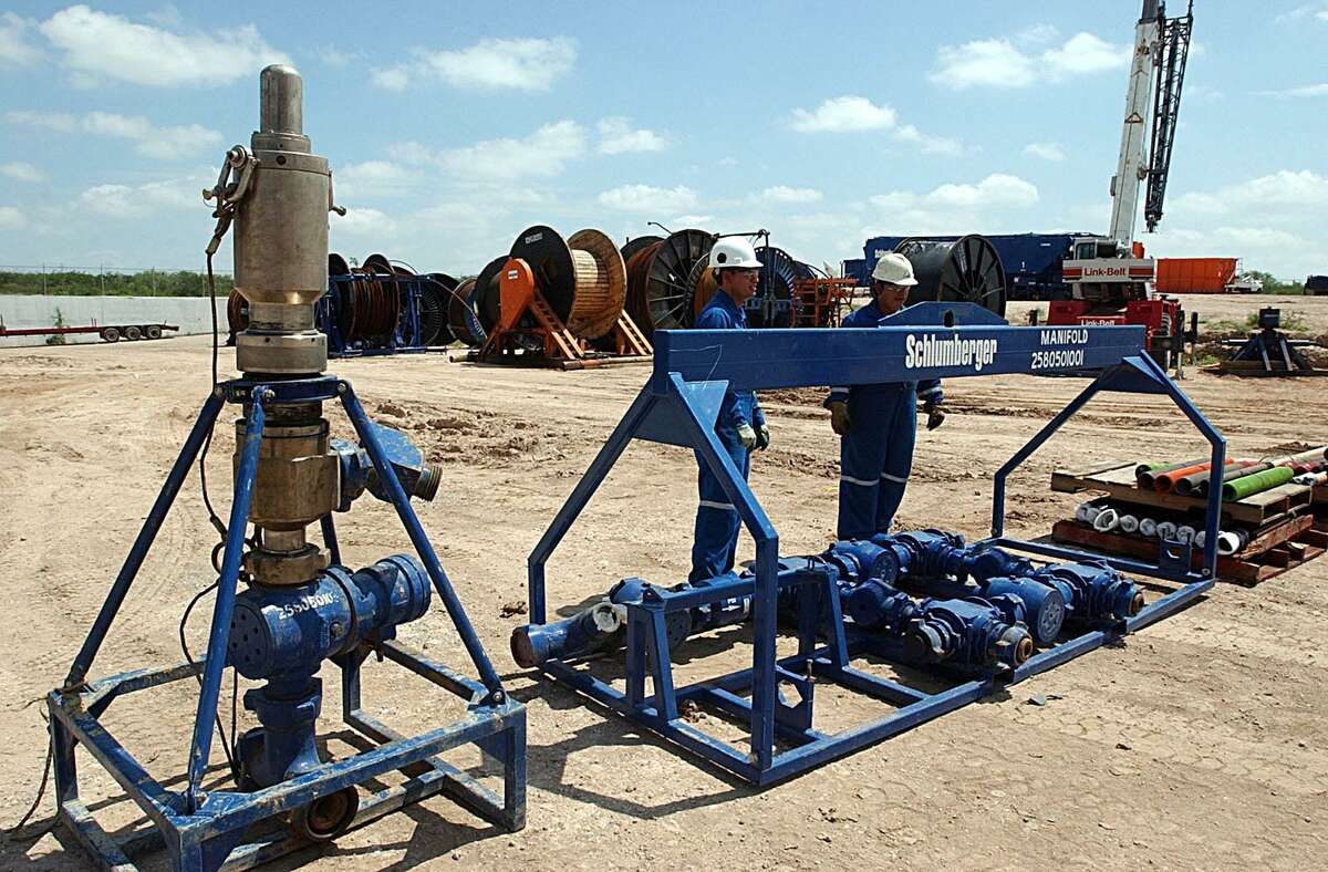 Employees with Schlumberger prepare to load equipment used in the field for natural gas in the Burgos Basin in Reynosa, Tamaulipas.