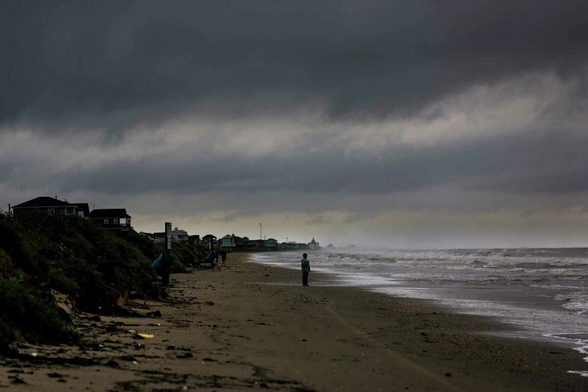 A man looks out from the beach the morning after Tropical Storm Cindy made landfall Thursday, June 22, 2017 on the Bolivar Peninsula. ( Michael Ciaglo / Houston Chronicle )