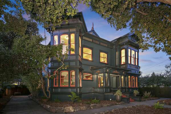 """The 1885 """"DeRome House"""" mansion dominates a magical compound on a flat, spacious lot at 1076 59th St. in Oakland. The property also includes two remodeled condos."""