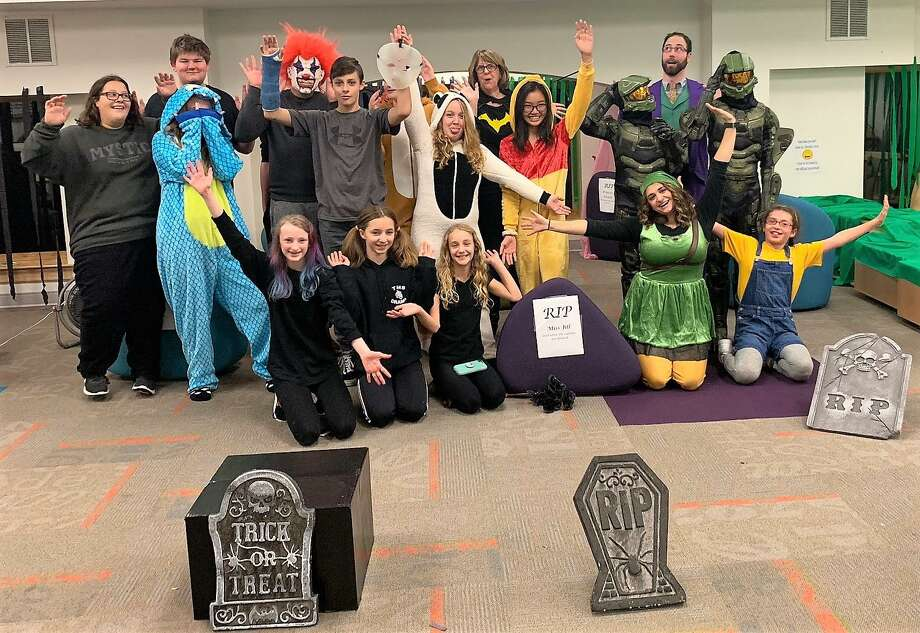 The Torrington Library held a very well-attended Halloween Bash in 2017. Many costumed children like these are expected at Torrington's Trunk or Treat, set for Oct. 26 at the Torrington Armory. Photo: Contributed Photo /