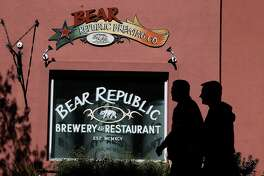 Pedestrians walk by the Bear Republic Brewery and Restaurant on February 21, 2014 in Healdsburg, California.