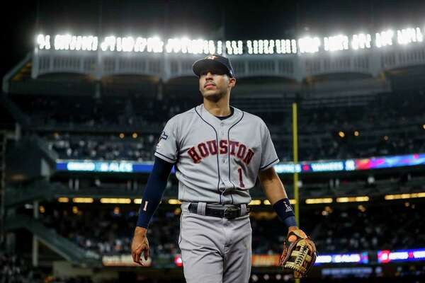 Houston Astros shortstop Carlos Correa (1) walks back to the dugout before the start of Game 5 of the American League Championship Series at Yankee Stadium on Friday, Oct. 18, 2019, in New York.