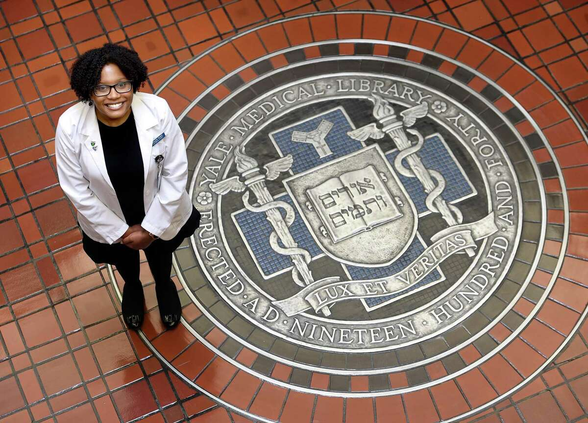 Chelesa Fearce, who has moved form homelessness to being accepted as a student at the Yale School of Medicine, is photographed near the entrance to the Harvey Cushing/John Hay Whitney Medical Library in New Haven on Oct. 14, 2019.