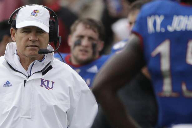 Kansas head coach Les Miles watches during the first half of an NCAA college football game against Oklahoma Saturday, Oct. 5, 2019, in Lawrence, Kan. (AP Photo/Charlie Riedel)
