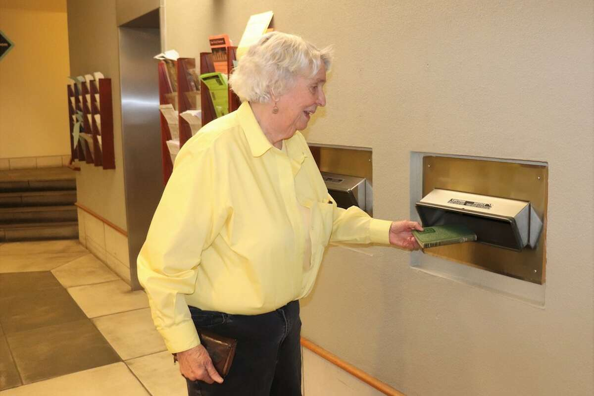 Berkeley resident Jean Durham returns a 74-years-overdue book at the Berkeley Public Library.