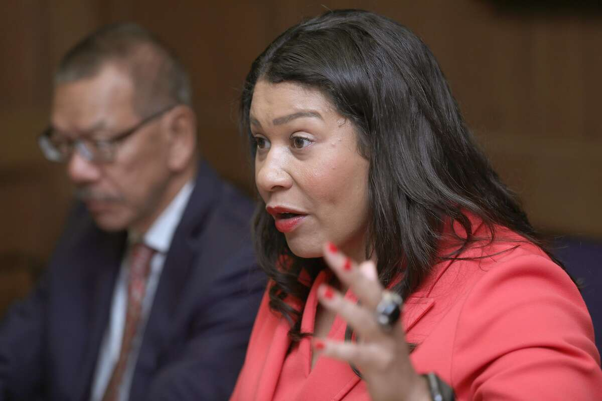 Mayor London Breed (right) and supervisor Norman Yee (left) talk about SF Proposition A at the San Francisco Chronicle on Monday, Sept. 16, 2019 in San Francisco, Calif.