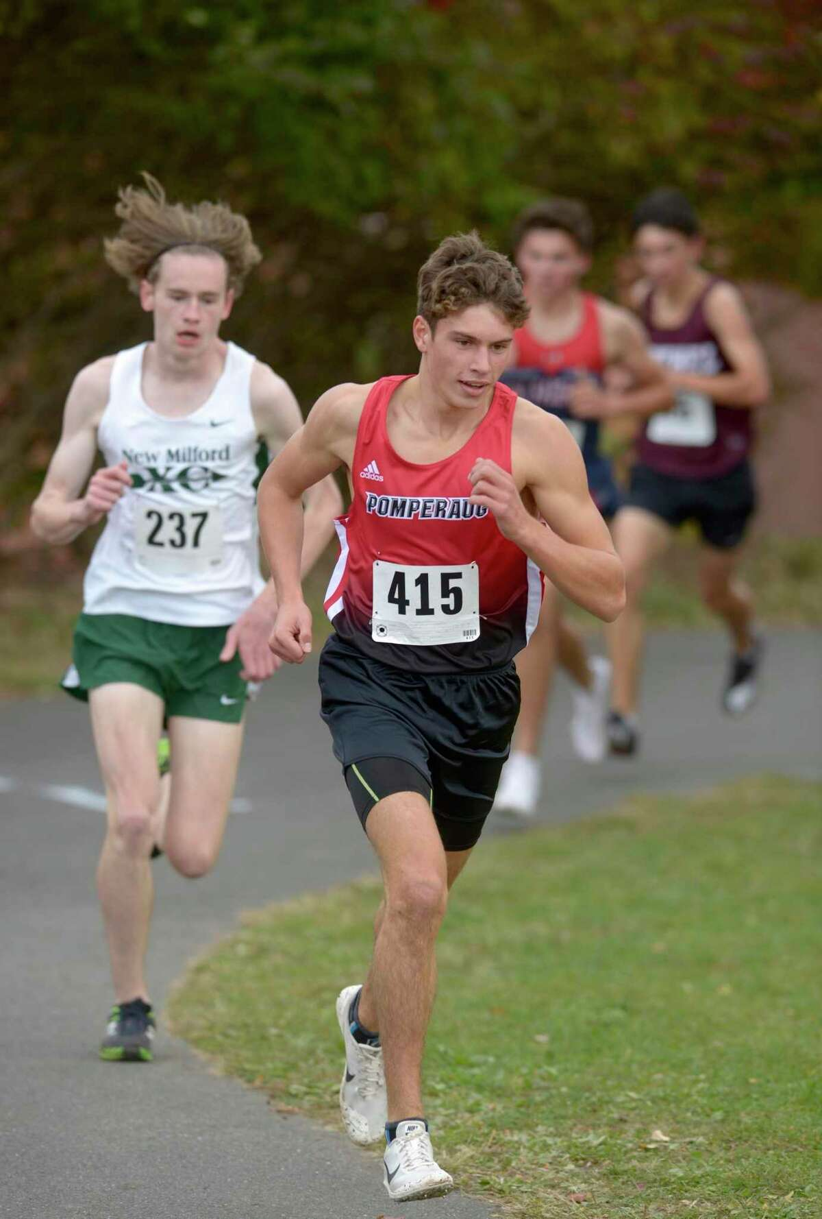 Pomperaug's Trey Generali (415) leads New Milford's Garred Farrell (237) in the boys SWC cross country championship race, Friday afternoon, October 18, 2019, at Bethel High School, Bethel, Conn. Generali finish first with a time of 16:39.15.