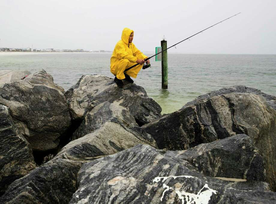 Michael Foster fishes as Tropical Storm Nestor approaches, Friday, Oct. 18, 2019 in Mexico Beach, Fla.. Forecasters say a disturbance moving through the Gulf of Mexico has become Tropical Storm Nestor. The National Hurricane Center says high winds and dangerous storm surge are likely along parts of the northern Gulf Coast. Conditions are expected to deteriorate Friday into early Saturday. (Joshua Boucher/News Herald via AP) Photo: Joshua Boucher, AP / Joshua Boucher | The News Herald MANDATORY CREDIT