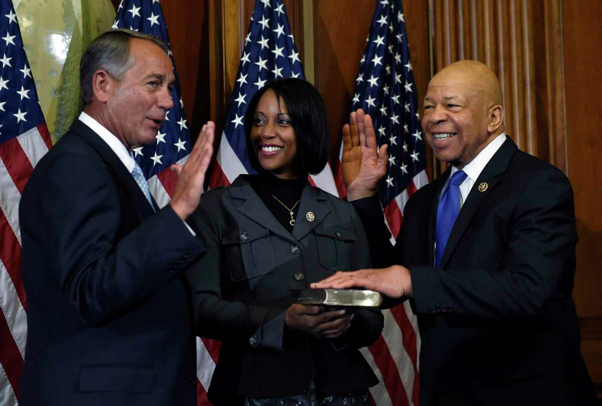 House Speaker John Boehner of Ohio poses for a photo with Rep. Elijah Cummings, D-Md., right, during a re-enactment the House oath-of-office, Tuesday, Jan. 6, 2015, on Capitol Hill in Washington. Cummings' wife Maya Rockeymoore is at center. (AP Photo/Susan Walsh)