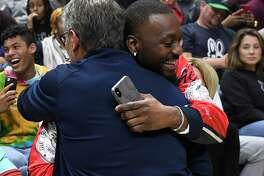 Boston Celtics' and former Connecticut player Kemba Walker, right, embraces Connecticut women's head coach Geno Auriemma during UConn's men's and women's basketball teams' annual First Night celebration in Storrs, Conn, Friday, Oct. 18, 2019. (AP Photo/Jessica Hill)
