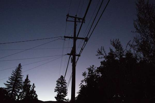 Power lines are seen against an early sunrise sky in Napa, Calif. Thursday, Oct. 10, 2019 due to a PG&E Public Safety Power Shutoffs across Northern California.
