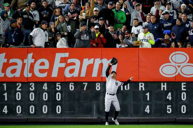 New York Yankees right fielder Aaron Judge (99) makes a catch at the wall on a fly out by Houston Astros catcher Robinson Chirinos during the sixth inning of Game 5 of the American League Championship Series at Yankee Stadium on Friday, Oct. 18, 2019, in New York.