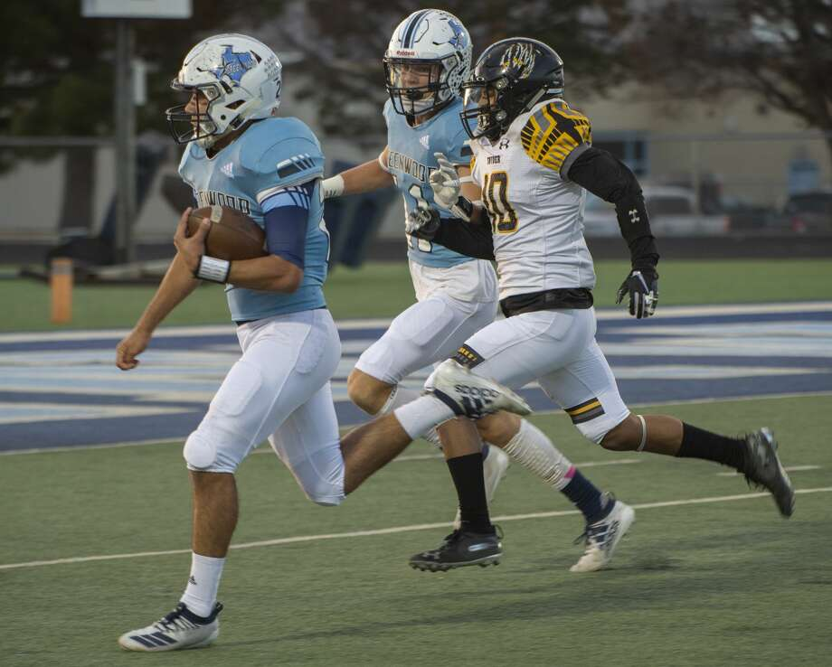 Greenwood's Ryan Snodgrass races past Snyder's Kaden Vess on the way to a touchdown 10/18/19 at J.M. King Memorial Stadium. Tim Fischer/Reporter-Telegram Photo: Tim Fischer/Midland Reporter-Telegram
