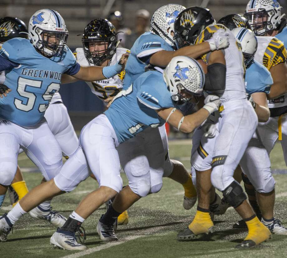 Snyder's Greg Williams is stopped for a loss by the Greenwood defensive line 10/18/19 at J.M. King Memorial Stadium. Tim Fischer/Reporter-Telegram Photo: Tim Fischer/Midland Reporter-Telegram