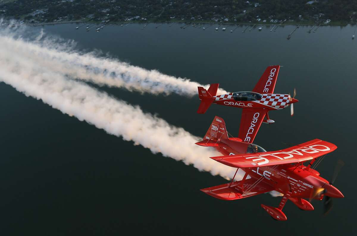 Sean D. Tucker, front, performs aerial maneuvers in his one-of-a-kind, cherry red-and-white aerobatic biplane before it heads to the National Air and Space Museum on Friday, Oct. 18, 2019, in Houston. Tucker was performing with team member Jessy Panzer. Tucker performed in Wings over Houston that weekend, the last performance for the Oracle Challenger III airplane.