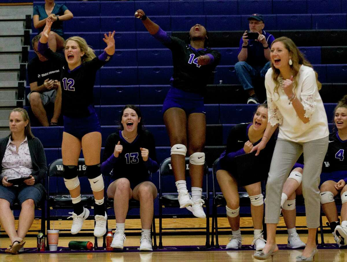 FILE PHOTO - Willis players react after a point during the second set of a District 20-5A high school volleyball match at Willis High School, Tuesday, Oct. 1, 2019, in Willis.