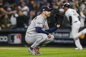 Houston Astros starting pitcher Justin Verlander (35) reacts after giving up a three-run home run to New York Yankees center fielder Aaron Hicks (31) during the first inning of Game 5 of the American League Championship Series at Yankee Stadium on Friday, Oct. 18, 2019, in New York.