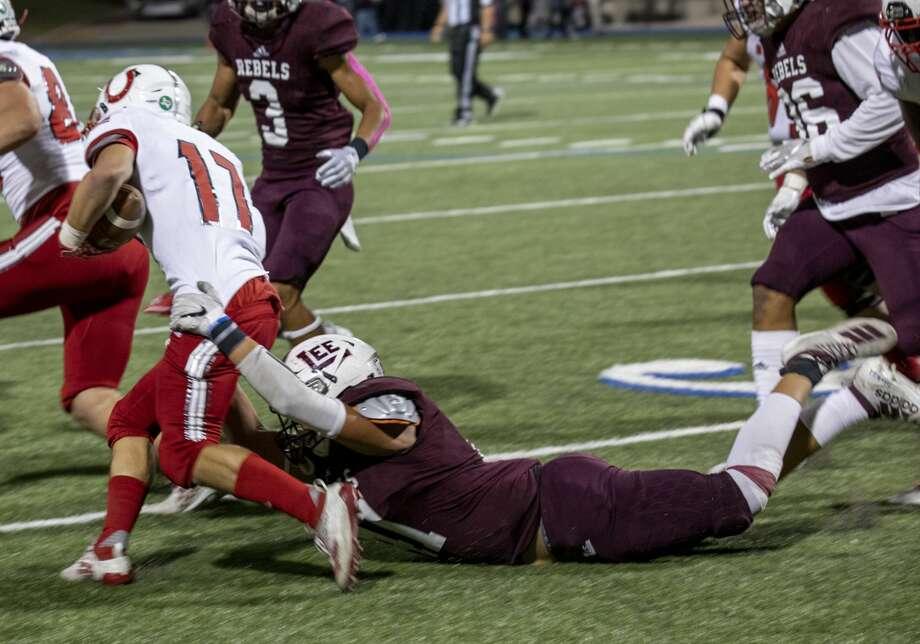 Lee's Elijah Nunez tackles Odessa High's Daymein Jordan (17) on Friday, Oct. 18, 2019 at Grande Communications Stadium. Photo: Jacy Lewis/Reporter-Telegram