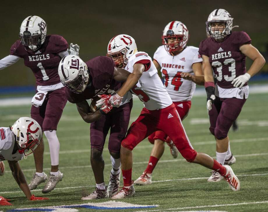 Lee's Loic Fouonji is tackled by Odessa High's Roberto Hernandez on Friday, Oct. 18, 2019 at Grande Communications Stadium. Photo: Jacy Lewis/Reporter-Telegram