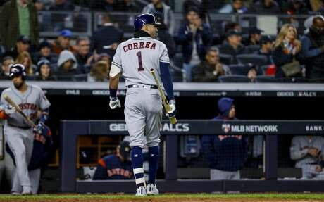 Houston Astros shortstop Carlos Correa (1) walks to the dugout after striking out during the eighth inning of Game 5 of the American League Championship Series at Yankee Stadium on Friday, Oct. 18, 2019, in New York.