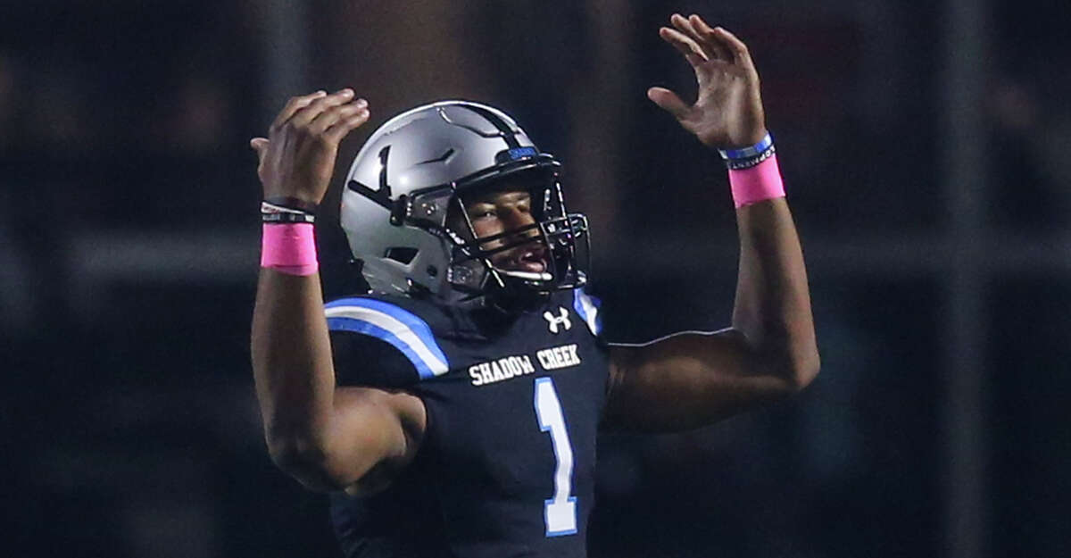 Shadow Creek's Kyron Drones (1) celebrates passing a touchdown against Friendswood in the first half on October 18 at Freedom Field in Rosharon, TX.