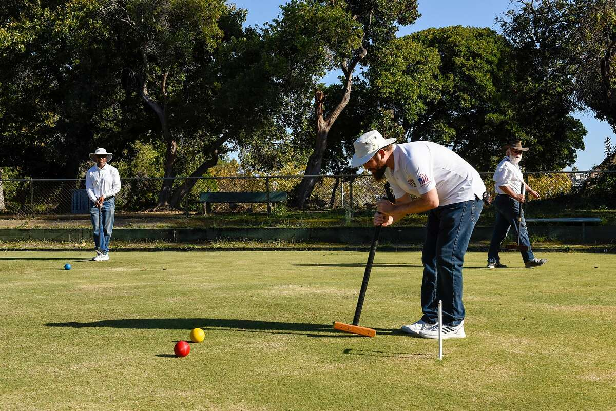 Reuben Edwards, Ben Rothman and Rick Smith world champion of golf croquet, practice at the Oakland Croquet Club on October 17, 2019 in Oakland, Calif.